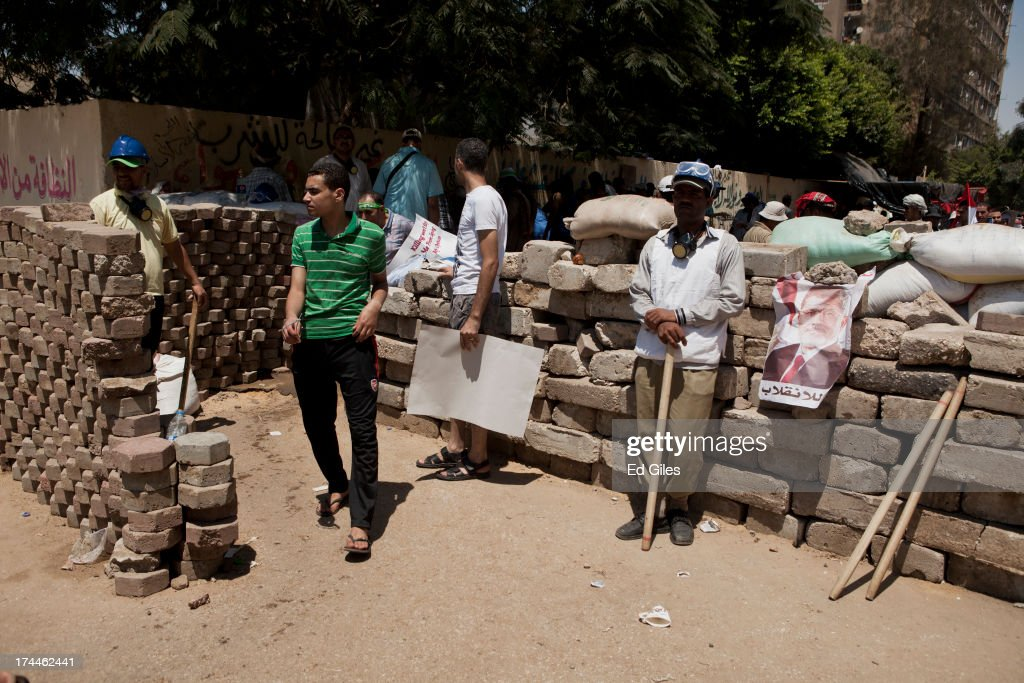 Supporters of deposed Egyptian President Mohammed Morsi stand at a checkpoint at the edge of a demonstration in support of deposed Egyptian President...