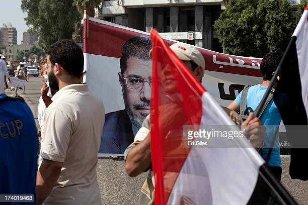 Supporters of deposed Egyptian President Mohammed Morsi take part in a demonstration near Cairo University in the district of Giza on July 19 2013 in...