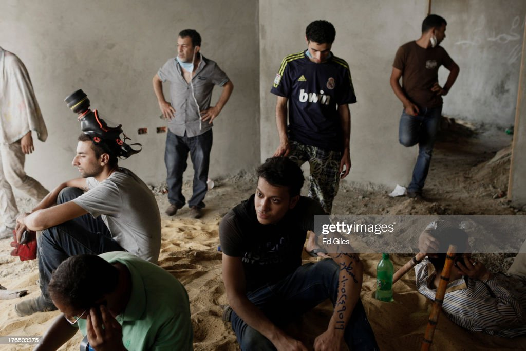 Supporters of deposed Egyptian President Mohammed Morsi take shelter inside a construction site during a violent crackdown by Egyptian Security...
