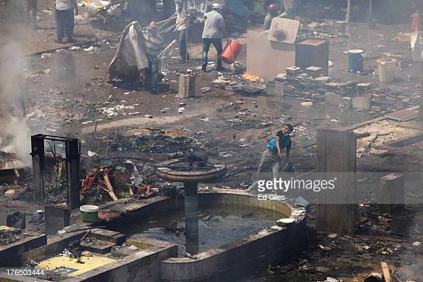 Supporters of deposed Egyptian President Mohammed Morsi throw rocks while taking cover among debris during a violent crackdown by Egyptian Security...