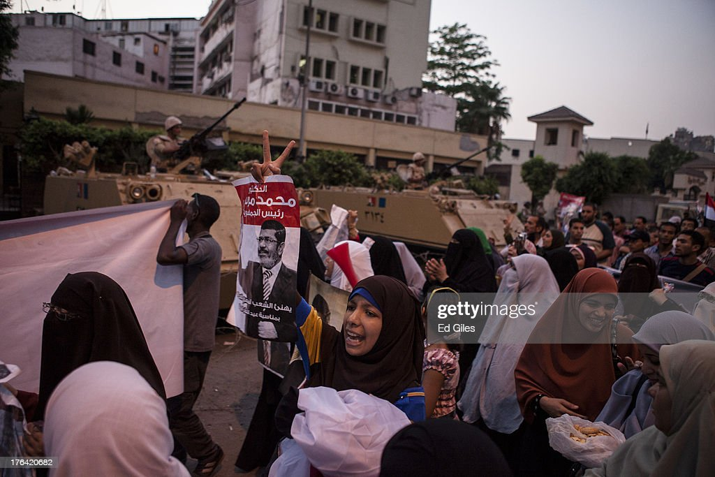 Supporters of deposed Egyptian President Mohammed Morsi yell chants at Egyptian Soldiers during a protest march in the Giza district on August 12, 2013 in Cairo, Egypt. Egyptian security forces threatened to begin a siege of pro-Morsi protest camps in Cairo overnight on August 11, however Egypt's Interior Ministry appeared to have put off plans to crack down on protesters early on August 12. On Monday Egypt's judiciary also extended deposed President Morsi's detention for a further 15 days pending investigation into charges of his collaboration with the Palestinian Hamas movement. Morsi supporters have continued to protest at sites across Cairo over one month after the Egyptian military deposed Egypt's first democratically elected President, Mohammed Morsi, on July 3. (Photo by Ed Giles/Getty Images).