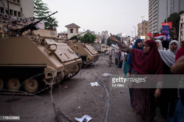 Supporters of deposed Egyptian President Mohammed Morsi yell chants at Egyptian Soldiers during a protest march in the Giza district on August 12...