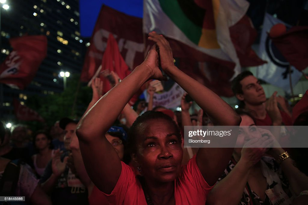 Supporters of Dilma Rousseff Brazil's president not pictured cheer during a demonstration in Rio de Janeiro Brazil on Thursday March 31 2016...
