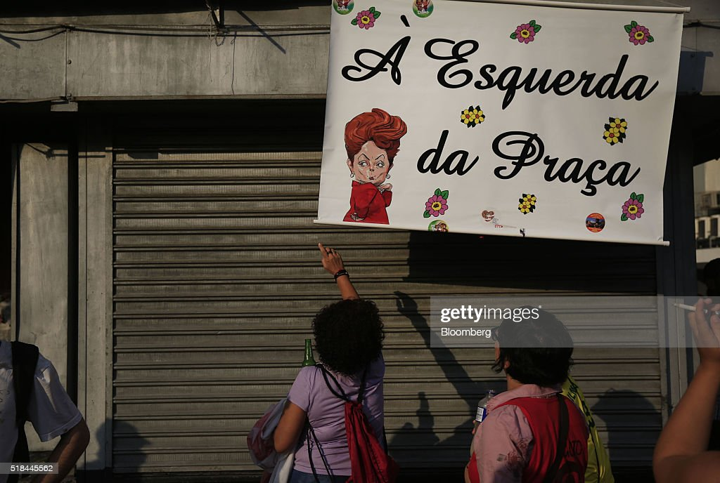 Supporters of Dilma Rousseff Brazil's president not pictured hang a banner during a demonstration in Rio de Janeiro Brazil on Thursday March 31 2016...