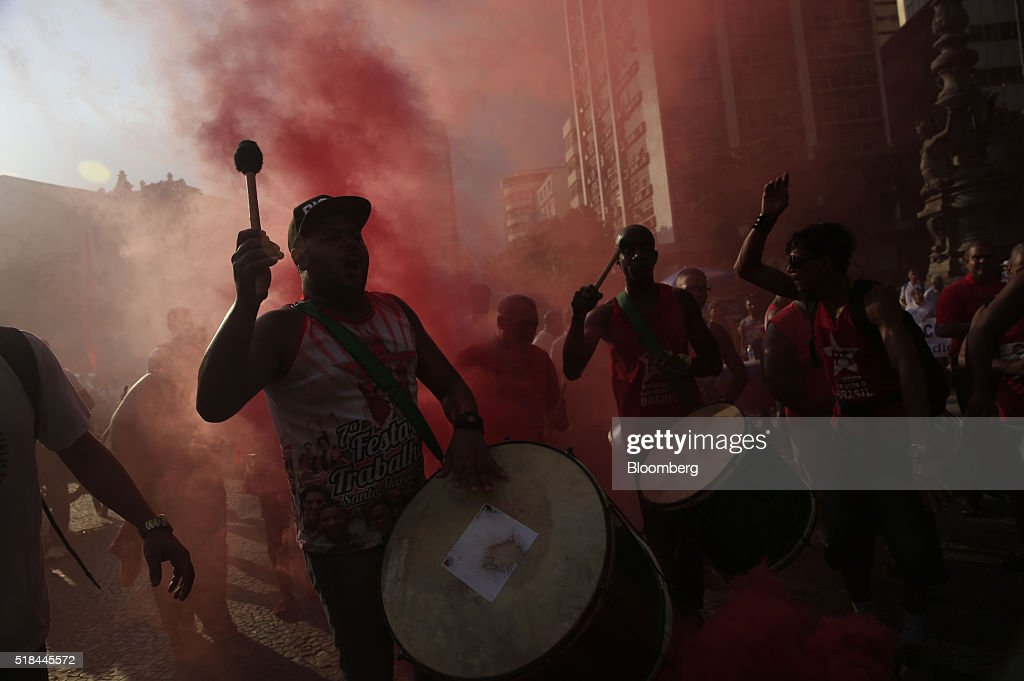 Supporters of Dilma Rousseff Brazil's president not pictured play drums in red smoke during a demonstration in Rio de Janeiro Brazil on Thursday...