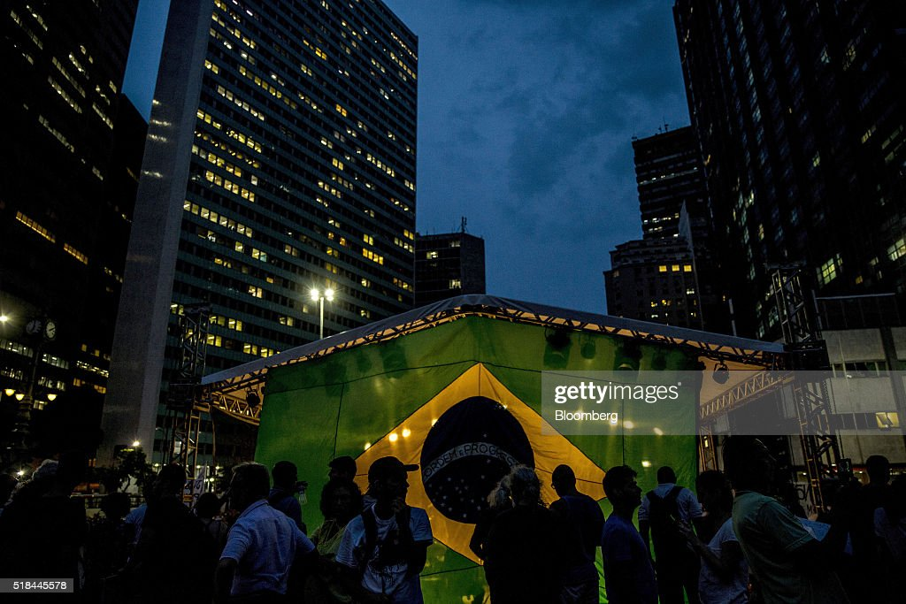 Supporters of Dilma Rousseff Brazil's president not pictured stand in front of a Brazilian during a demonstration in Rio de Janeiro Brazil on...