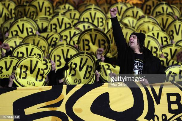 Supporters of Dortmund cheer before the Bundesliga match between 1 FC Nuernberg and Borussia Dortmund at Easy Credit Stadium on December 5 2010 in...