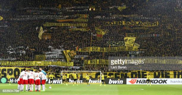 Supporters of Dortmund display banners prior to the Bundesliga match between Borussia Dortmund and RB Leipzig at Signal Iduna Park on February 4 2017...