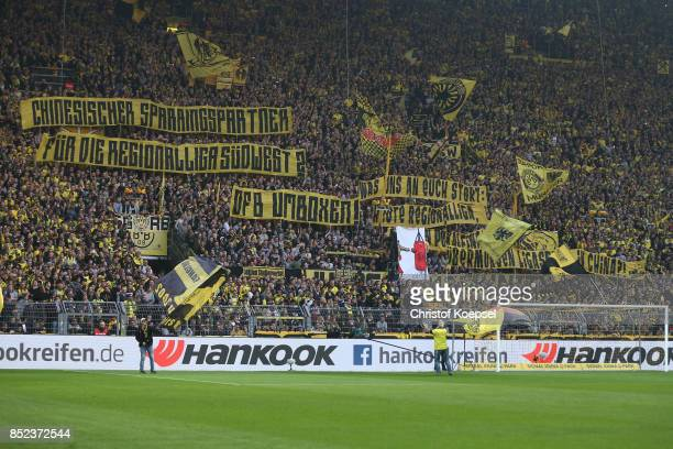 Supporters of Dortmund voice their frustration with the DFB on banners before the Bundesliga match between Borussia Dortmund and Borussia...