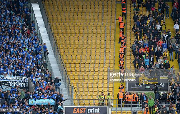 Supporters of Dresden and Chemnitz provoke each other during the Third League match between SG Dynamo Dresden and Chemnitzer FC at Stadion Dresden on...