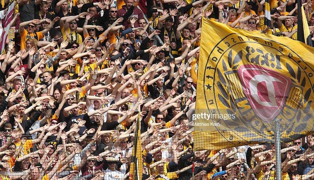 Supporters of Dresden celebrate their team during the third league match between SG Dynamo Dresden and Erzgebirge Aue at DDV Stadion Dresden on April 30, 2016 in Dresden, Germany.