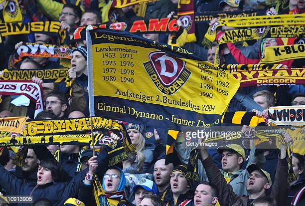 Supporters of Dresden cheer during the Third League match between Dynamo Dresden and 1 FC Heidenheim at the Rudolf Harbig Stadium on March 26 2011 in...