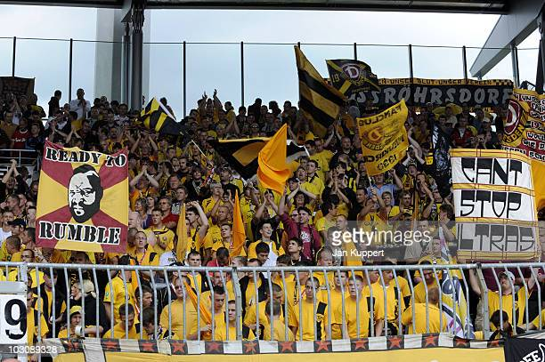 Supporters of Dresden cheer on their team during the third Liga match between Eintracht Braunschweig and Dynamo Dresden on July 24 2010 in...