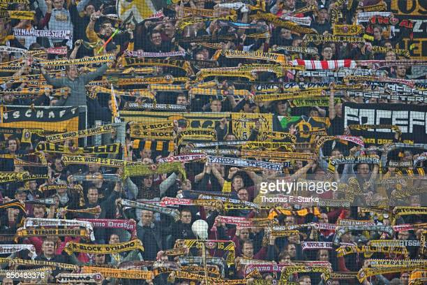 Supporters of Dresden cheer their team during the Second Bundesliga match between SG Dynamo Dresden and DSC Arminia Bielefeld at DDVStadion on...