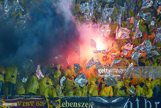 Supporters of Dresden fire smoke bombs during the Second Bundesliga match between Arminia Bielefeld and Dynamo Dresden at Schueco Arena on December 6...