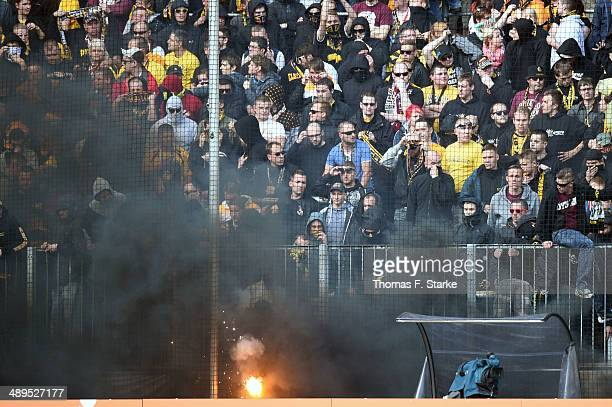 Supporters of Dresden fire smoke bombs during the Second Bundesliga match between Dynamo Dresden and Arminia Bielefeld at GluecksgasStadion on May 11...