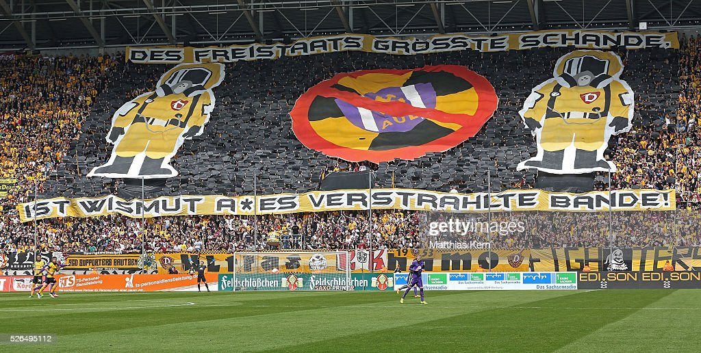 Supporters of Dresden show a banner during the third league match between SG Dynamo Dresden and Erzgebirge Aue at DDV Stadion Dresden on April 30, 2016 in Dresden, Germany.