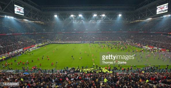 Supporters of Duesseldorf enter the pitch during the Bundesliga Relegation match between Fortuna Duesseldorf and Hertha BSC Berlin at EspritArena on...