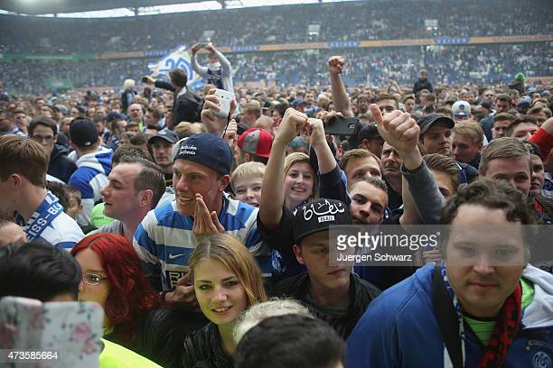 Supporters of Duisburg celebrate after the 3rd Bundesliga match between MSV Duisburg and Holstein Kiel at SchauinslandReisenArena on May 16 2015 in...