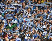 Supporters of Duisburg cheer their team during the Second Bundesliga match between MSV Duisburg and Arminia Bielefeld at SchauinslandReisenArena on...