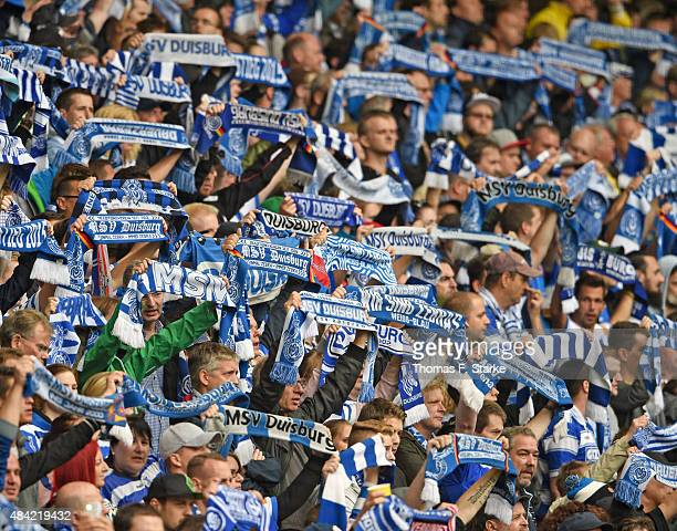 Supporters of Duisburg cheer their team during the Second Bundesliga match between MSV Duisburg and Arminia Bielefeld at SchauinslandReisenArena on...