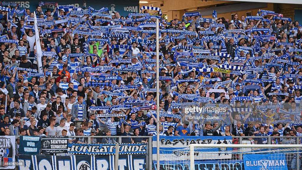 Supporters of Duisburg cheer their team during the Third League match between MSV Duisburg and Arminia Bielefeld at Schauinsland-Reisen-Arena on August 27, 2014 in Duisburg, Germany.