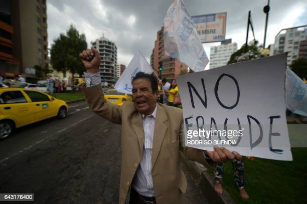 Supporters of Ecuadorean presidential candidate for the CREO party Guillermo Lasso protest outside the National Electoral Council in Quito on...
