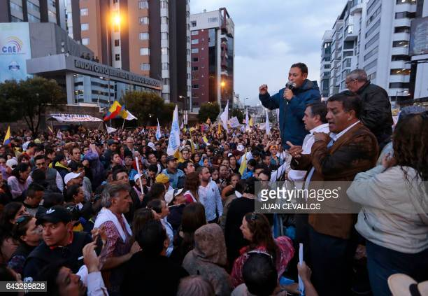 Supporters of Ecuadorean presidential candidate for the CREO party Guillermo Lasso gather outside the National Electoral Council to wait for for the...