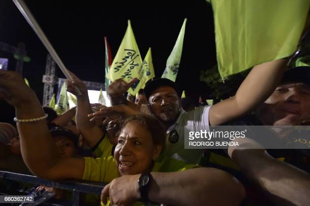 Supporters of Ecuadorean presidential candidate for the ruling Alianza Pais party Lenin Moreno cheer during his campaign closing rally in Portoviejo...