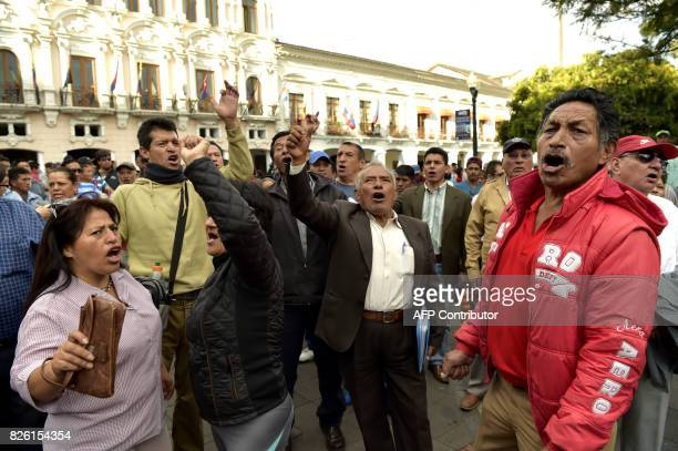 Supporters of Ecuadorean vice president Jorge Glas chant slogans against President Lenin Moreno at PLaza Grande square en Quito on August 3 2017...