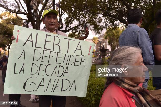 Supporters of Ecuadorean vice president Jorge Glas protest against President Lenin Moreno at PLaza Grande square en Quito on August 3 2017 Ecuador's...