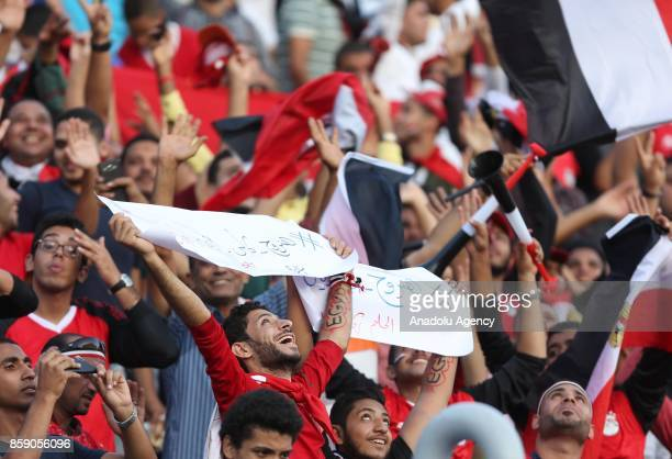 Supporters of Egypt hold banners during the 2018 World Cup Africa Qualifying match between Egypt and Congo at the Borg elArab Stadium in Alexandria...