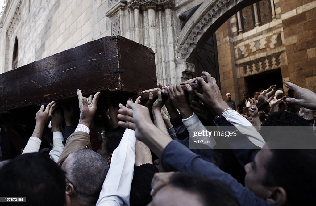 Supporters of Egyptian President Mohammed Morsi carry a casket containing the body of a Muslim Brotherhood member, killed in clashes with anti-Morsi demonstrators two nights previously, during a funeral service at Al Azhar Mosque on December 7, 2012, in Cairo, Egypt. A funeral service for three members of the Muslim Brotherhood was held during Friday prayers in Cairo before the bodies were carried to a nearby cemetery for burial. Supporters of President Morsi and anti-Morsi protesters continue to hold opposing demonstrations across Egypt, as tensions in the country remain high after a draft constitution was rushed through the country's parliament overnight on November 29. The country's new draft constitution, passed by a constitutional assembly dominated by Islamists, will go to a referendum on December 15. (Photo by Ed Giles/Getty Images).
