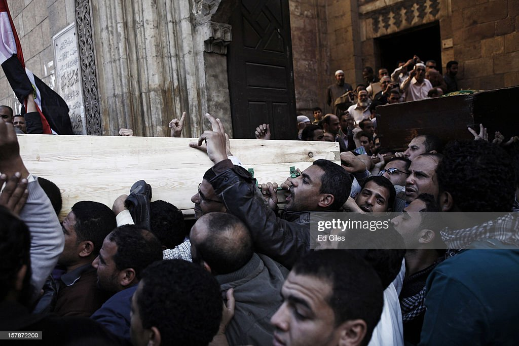 Supporters of Egyptian President Mohammed Morsi carry caskets containing the bodies of Muslim Brotherhood members, killed in clashes with anti-Morsi demonstrators two nights previously, during a funeral service at Al Azhar Mosque on December 7, 2012, in Cairo, Egypt. A funeral service for three members of the Muslim Brotherhood was held during Friday prayers in Cairo before the bodies were carried to a nearby cemetery for burial. Supporters of President Morsi and anti-Morsi protesters continue to hold opposing demonstrations across Egypt, as tensions in the country remain high after a draft constitution was rushed through the country's parliament overnight on November 29. The country's new draft constitution, passed by a constitutional assembly dominated by Islamists, will go to a referendum on December 15. (Photo by Ed Giles/Getty Images).