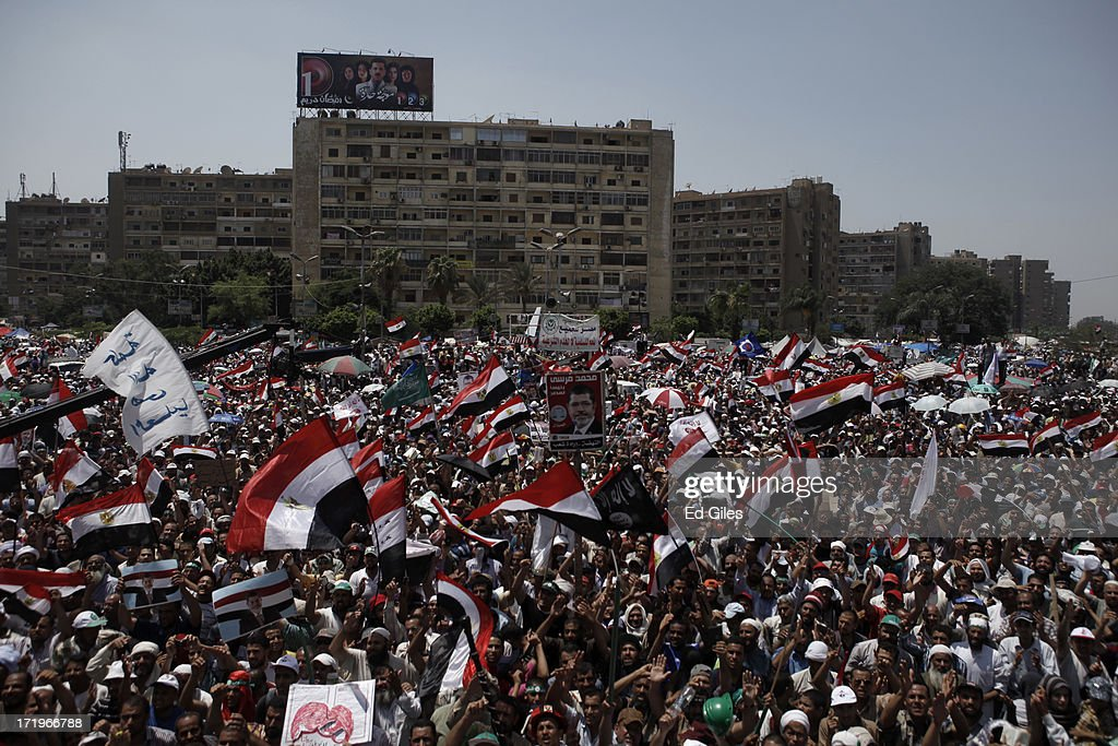 Supporters of Egyptian President Mohammed Morsi chant during a demonstration at the Rabaa alAdaweya Mosque in the suburb of Nasr City on June 30 2013...