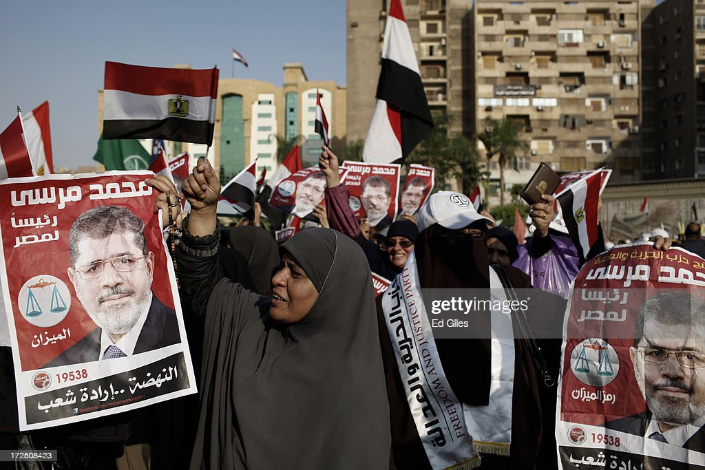 Supporters of Egyptian President Mohammed Morsi demonstrate at the Rabaa al Adawiya Mosque in the suburb of Nasr City on July 2, 2013 in Cairo, Egypt. In a statement on July 1, the Egyptian Army asked Egyptian President Mohammed Morsi to resolve mass demonstrations against his continued rule or face intervention by the military within 48 hours. Crowds of pro- and anti-government protesters gathered in locations across Egypt on June 30, the day of a series of nation-wide mass demonstrations entitled 'Tamarod', or 'Rebel'. The 'Tamarod' campaign, organised by a coalition of opposition political groups and planned to take place on the first anniversary of Egyptian President Mohammed Morsi's election to the country's Presidency, aims to bring down the government of President Morsi through country-wide demonstrations.