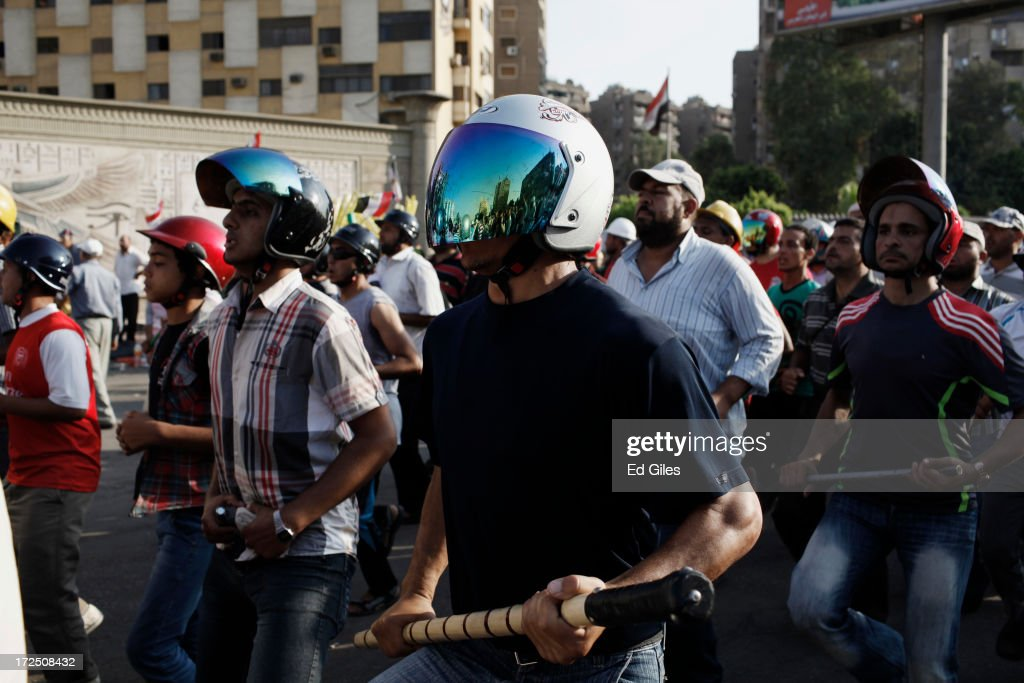 Supporters of Egyptian President Mohammed Morsi hold makeshift weapons and take part in a drill during a demonstration at the Rabaa al Adawiya Mosque in the suburb of Nasr City on July 2, 2013 in Cairo, Egypt. In a statement on July 1, the Egyptian Army asked Egyptian President Mohammed Morsi to resolve mass demonstrations against his continued rule or face intervention by the military within 48 hours. Crowds of pro- and anti-government protesters gathered in locations across Egypt on June 30, the day of a series of nation-wide mass demonstrations entitled 'Tamarod', or 'Rebel'. The 'Tamarod' campaign, organised by a coalition of opposition political groups and planned to take place on the first anniversary of Egyptian President Mohammed Morsi's election to the country's Presidency, aims to bring down the government of President Morsi through country-wide demonstrations.