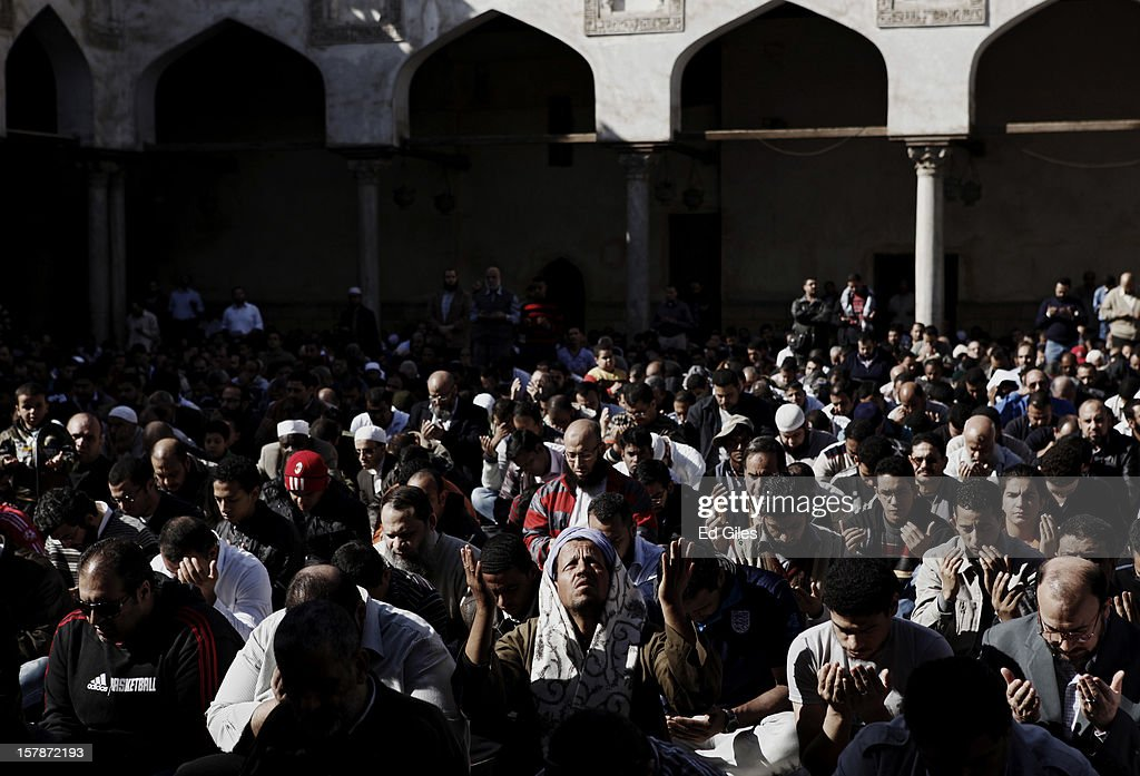 Supporters of Egyptian President Mohammed Morsi pray during a funeral service for three Muslim Brotherhood members, killed in clashes with anti-Morsi demonstrators two nights previously, at Al Azhar Mosque on December 7, 2012, in Cairo, Egypt. A funeral service for three members of the Muslim Brotherhood was held during Friday prayers in Cairo before the bodies were carried to a nearby cemetery for burial. Supporters of President Morsi and anti-Morsi protesters continue to hold opposing demonstrations across Egypt, as tensions in the country remain high after a draft constitution was rushed through the country's parliament overnight on November 29. The country's new draft constitution, passed by a constitutional assembly dominated by Islamists, will go to a referendum on December 15. (Photo by Ed Giles/Getty Images).