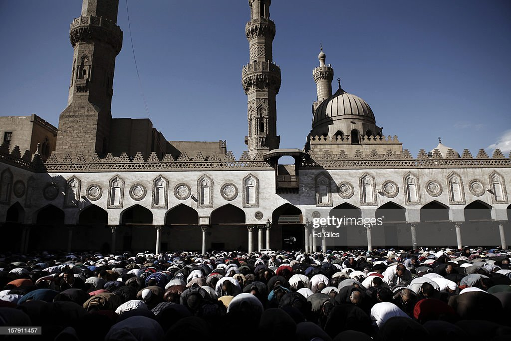 Supporters of Egyptian President Mohammed Morsi pray during a funeral service for three Muslim Brotherhood members, killed in clashes with anti-Morsi demonstrators two nights previously, at Al Azhar Mosque on December 7, 2012 in Cairo, Egypt. A funeral service for three members of the Muslim Brotherhood was held during Friday prayers in Cairo before the bodies were carried to a nearby cemetery for burial. Supporters of President Morsi and anti-Morsi protesters continue to hold opposing demonstrations across Egypt, as tensions in the country remain high after a draft constitution was rushed through the country's parliament overnight on November 29. The country's new draft constitution, passed by a constitutional assembly dominated by Islamists, will go to a referendum on December 15.