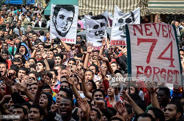 Supporters of Egypt's AlAhly football club protest outside the public prosecutor's office in Cairo on March 16 demanding the release of fellow...