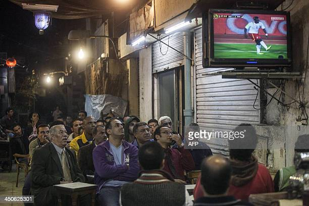 Supporters of Egypts national football team watch the match of the 2014 World Cup African zone qualifier second leg football playoff against Ghana in...