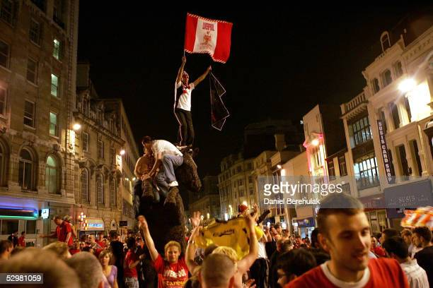 Supporters of English football club Liverpool celebrate after their club's victory against AC Milan in the UEFA Champions League football final match...