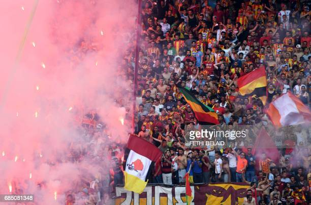 Supporters of Esperance de Tunis cheer for their team during the Tunisian Championship match against Etoile du Sahel at the Olympus Rades stadium on...
