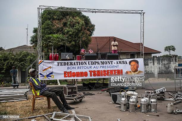 Supporters of Etienne Tsisekedi await at a stage in front of his residence in Kinshasa on July 27 2016 as Congo's veteran opposition chief comes home...
