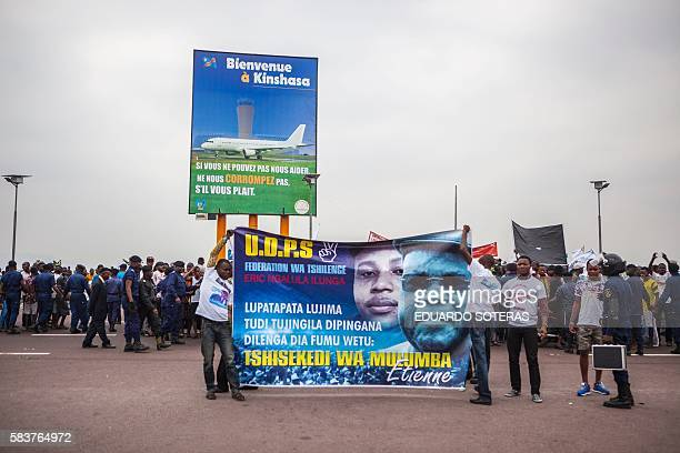 Supporters of Etienne Tsisekedi hold placards as they await for his arrival at the airport of Kinshasa on July 27 2016 as Congo's veteran opposition...