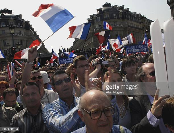 Supporters of extremist rightwing leader JeanMarie Le Pen attend his traditional May Day speech at the Place de l'Opera in Paris