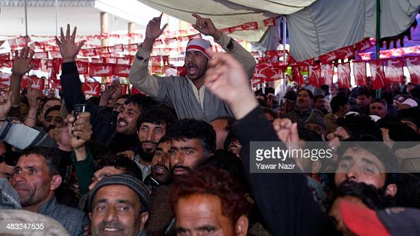 Supporters of Farooq Abdullah a minister in the Indian government and patron of the proIndia National Conference party and a contesting candidate...