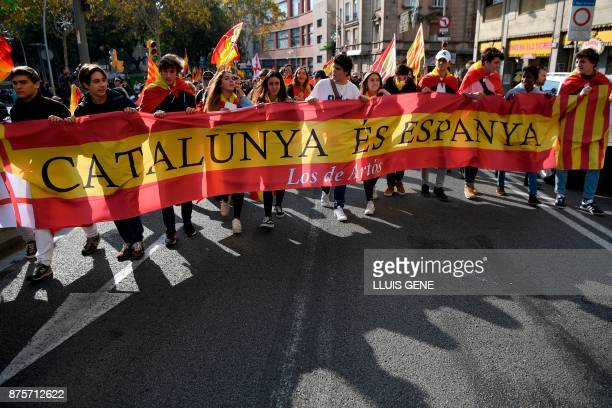 Supporters of fascist movements hold a Spanish flag reading 'Catalonia is Spain' during a demonstration in Artos Square in Barcelona on November 18...