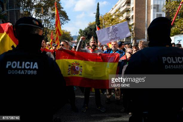 Supporters of fascist movements shout slogans while holding a Spanish flag during a demonstration in Artos Square in Barcelona on November 18 2017 on...