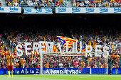 Supporters of FC Barcelona show a message reading 'We will be free' supporting the independence of Catalonia during the La Liga match between FC...